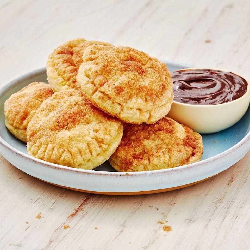 """<p>We are obsessed with <a href=""""https://www.delish.com/uk/cooking/recipes/a29733984/easy-churros-recipe/"""" rel=""""nofollow noopener"""" target=""""_blank"""" data-ylk=""""slk:churros"""" class=""""link rapid-noclick-resp"""">churros</a> and love making them at home, but sometimes we don't have the time to fry up a fresh batch. These cookies are the perfect solution. Caramel gets sandwiched between puff pastry and then tossed in cinnamon sugar for a simple and fast, yet completely addicting treat. </p><p>Get the <a href=""""https://www.delish.com/uk/cooking/recipes/a29984869/churro-cookies-recipe/"""" rel=""""nofollow noopener"""" target=""""_blank"""" data-ylk=""""slk:Churro Cookies"""" class=""""link rapid-noclick-resp"""">Churro Cookies</a> recipe.</p>"""