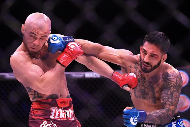 Henry Corrales (R) is always ready to dole out damage in the MMA ring. (Jayne Kamin-Oncea/Getty Images)