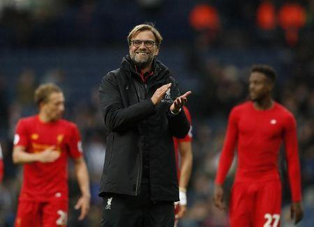 Liverpool manager Juergen Klopp applauds fans after the match
