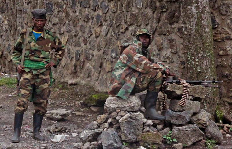M23 rebel soldiers take positions near the Heal Africa hospital in the center of Goma, Congo, Tuesday, Nov. 20, 2012. A rebel group created just seven months ago seized the strategic provincial capital of Goma, home to more than 1 million people in eastern Congo, and its international airport on Tuesday, officials and witnesses said, raising the specter of a regional war. (AP Photo/Melanie Gouby)