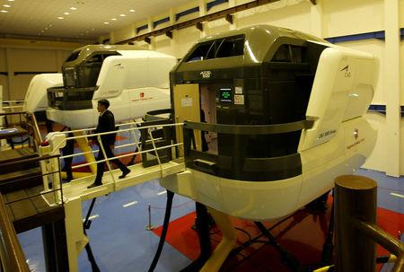 A pilot of Lion Air Group leaves an aircraft simulator after a routine practice session at Angkasa Training Center near Jakarta