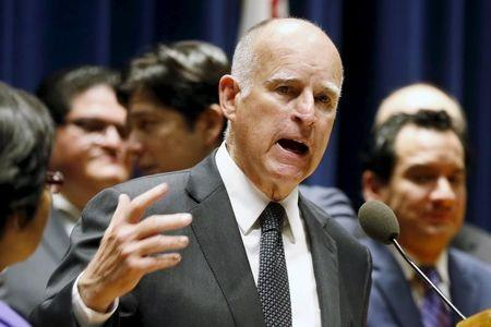 California Governor Jerry Brown speaks before signing a bill hiking California's minimum wage to $15 by 2023 in Los Angeles