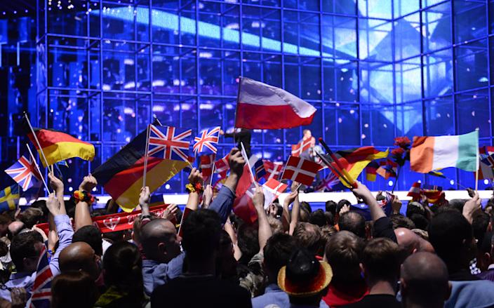 Supporters wave flags ahead of the Eurovision Song Contest 2014 Grand Final in Copenhagen, Denmark, on May 10, 2014. AFP PHOTO/JONATHAN NACKSTRAND via Getty Images.