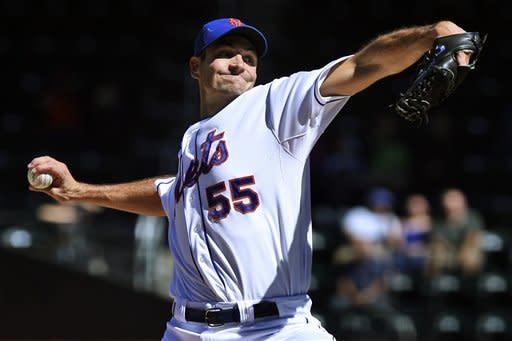 New York Mets starting pitcher Chris Young delivers during the first inning of a baseball game against the Miami Marlins, Sunday, Sept. 23, 2012, at Citi Field in New York. (AP Photo/Seth Wenig)