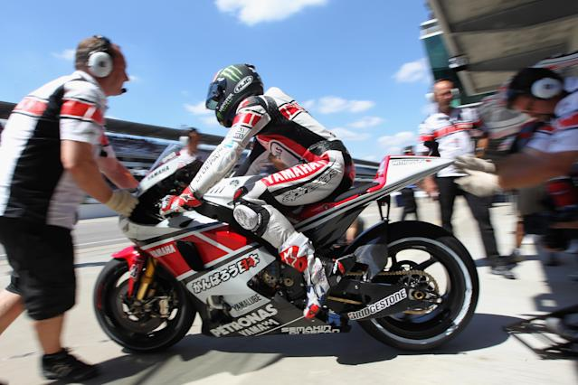 INDIANAPOLIS, IN - AUGUST 27: Ben Spies #11 of the USA leaves the pit garage during Moto GP qualifying at Indianapolis Motorspeedway on August 27, 2011 in Indianapolis, Indiana. (Photo by Jamie Squire/Getty Images)