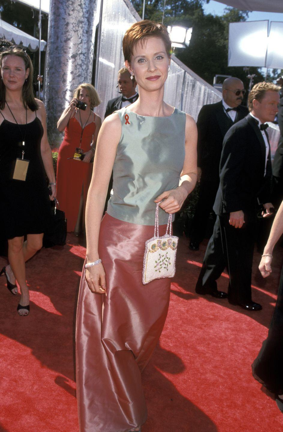<p>Nixon wore this shiny, color-blocked number to Emmy Awards in 1999. </p>