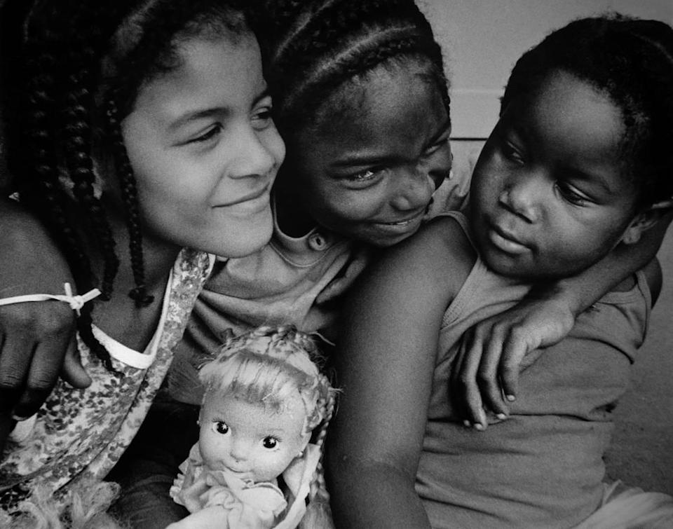 Children at play pause for a portrait in the early 1990s in Lexington, KY. (Photo by Jahi Chikwendiu) For one-time use by the Lexington Herald-Leader.