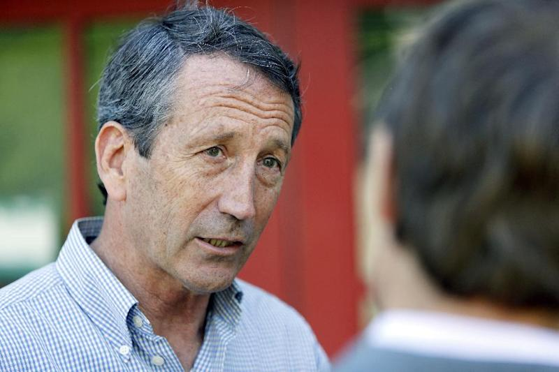 Former South Carolina Gov. Mark Sanford speaks to reporters outside of Orlando's Pizza in Daniel Island, S.C., on Monday, May 6, 2013. Sanford is making his last campaign push against his Democratic opponent, Elizabeth Colbert Busch, before Tuesday's special election. (AP Photo/Mic Smith)
