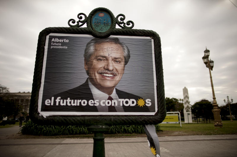 """FILE - In this Aug. 7, 2019 file photo, a billboard advertises pre-presidential candidate Alberto Fernandez, representing the """"Frente de Todos"""" political party, in Buenos Aires, Argentina. Farmers are bracing for a possible return of the interventionist policies of Maurico Macri's main - and now favored - rival: the presidential ticket of Alberto Fernández and former president Cristina Fernández. (AP Photo/Natacha Pisarenko, File)"""