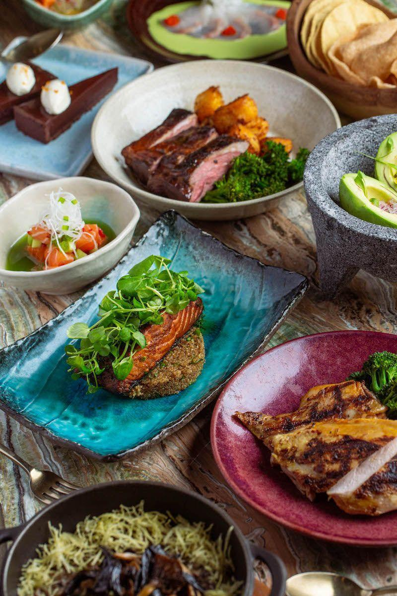 "<p>Head to South America for a four-course Peruvian feast with Mayfair's COYA food box. The feast for two will begin with corn tortillas, shrimp crackers and guacamole, followed by fresh ceviche options including Ceviche Criollo (sea bream with red onion, sweet potato and aji Amarillo), Salmon Pepino (salmon, jalapenos, cucumber and coriander) and Pez Limon (yellowtail with green chilli and radish). For mains, choose from lamb rump with aji panka and salmon fillet with stir-fried quinoa, soy and green vegetables. The rich and creamy Chocolate and orange tart with crème fraîche twill add a zing.<br></p><p>Feeling thirsty? Add <a href=""https://www.elle.com/uk/life-and-culture/travel/g30495431/best-cocktail-bars-london/"" rel=""nofollow noopener"" target=""_blank"" data-ylk=""slk:ready-to-pour cocktails"" class=""link rapid-noclick-resp"">ready-to-pour cocktails</a> to your order, including Negroni Time (thyme infused gin, sweet vermouth, Campari and COYA bitters), Claro Margarita (Reposado Tequila, agave, jalapeno and vanilla) and the Maracuya Martini (vanilla infused vodka, passion fruit and citrus). </p><p>Price: £110</p><p>Available across London</p><p>Order <a class=""link rapid-noclick-resp"" href=""https://www.coyarestaurant.com/coya-en-casa/#menu1"" rel=""nofollow noopener"" target=""_blank"" data-ylk=""slk:here"">here</a></p>"