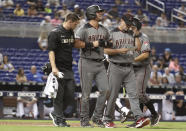 Arizona Diamondbacks' David Peralta, center, walks to first base after being hit by a pitch by Miami Marlins relief pitcher Tayron Guerrero during the ninth inning of a baseball game, Monday, July 29, 2019, in Miami. (AP Photo/Lynne Sladky)