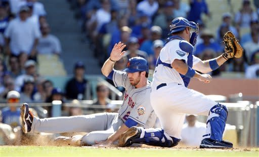 New York Mets' Daniel Murphy, left, beats the throw to Los Angeles Dodgers catcher A.J. Ellis, right, to score on a sacrifice fly during the second inning of their baseball game in Los Angeles, Saturday, June 30, 2012. (AP Photo/Alex Gallardo)