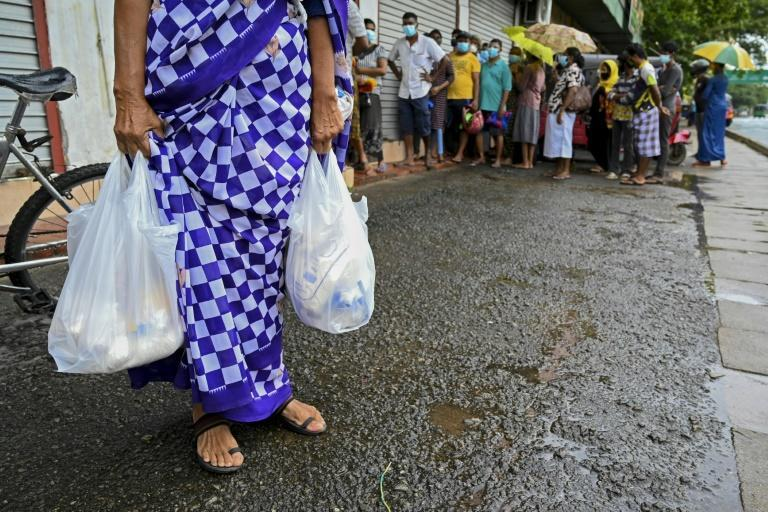 Sri Lanka's government insists the food shortages are artificially created by traders profiting from pandemic restrictions while experts have blamed the crisis on a shortage of foreign exchange for imports (AFP/Ishara S. KODIKARA)
