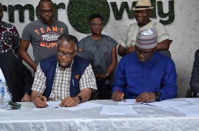 The Chairman, Best Foods L&P Limited, Mr. Emmanuel Ijewere and Founder and CEO of Farmcrowdy, Onyeka Akumah signing the acquisition deal at the Farmcrowdy office in Lagos, Nigeria.