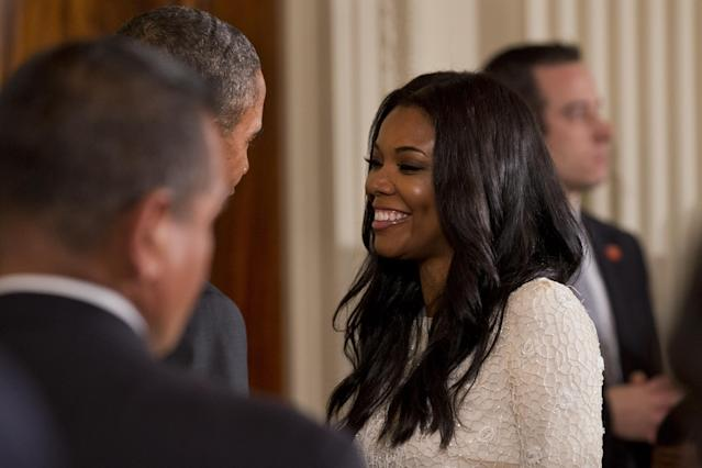 President Barack Obama, left, partially obscured, speaks with actress Gabrielle Union, fiance of Miami Heat basketball player Dwyane Wade, in the East Room of the White House in Washington, Tuesday, Jan. 14, 2014, after an event where the president honored the Miami Heat 2013 NBA Champion basketball team. (AP Photo/Jacquelyn Martin)