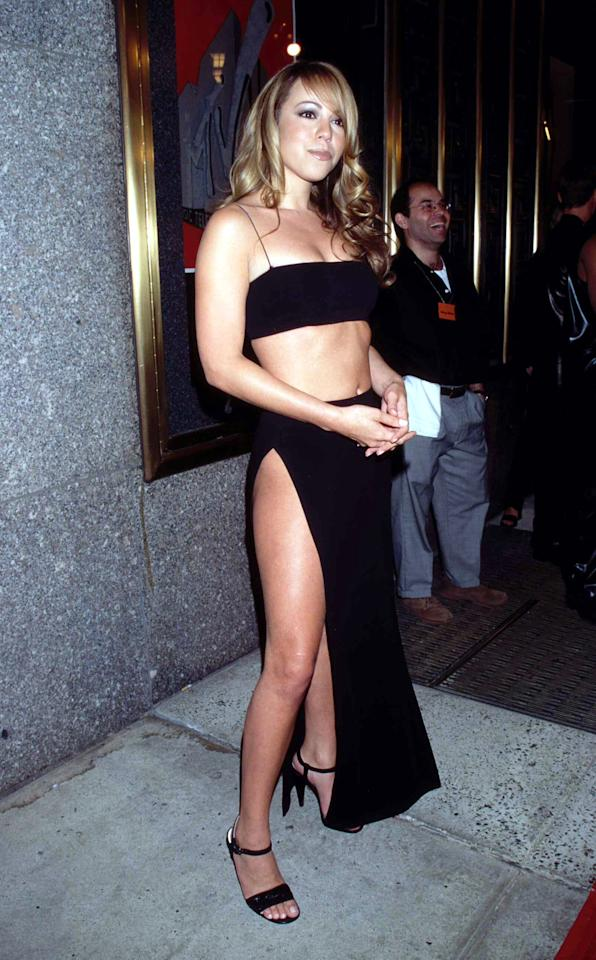 <p>Mariah Carey wears a black slit skirt paired with a black bandeau crop top out in New York City, a look she paired with simple strappy heels.</p>