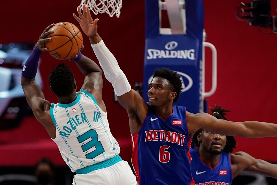 Charlotte Hornets guard Terry Rozier (3) shoots over the defense of Detroit Pistons guard Hamidou Diallo (6) during the second half at Little Caesars Arena in Detroit on Tuesday, May 4, 2021.