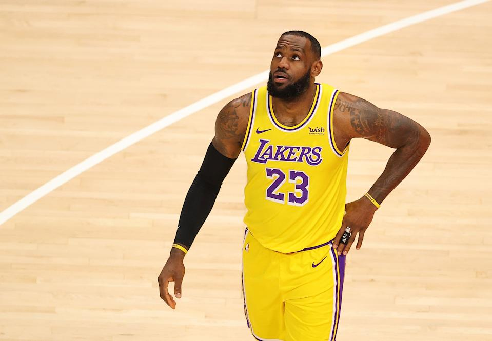 ATLANTA, GEORGIA - FEBRUARY 01:   LeBron James #23 of the Los Angeles Lakers reacts after drawing a foul from Cam Reddish #22 of the Atlanta Hawks during the first half at State Farm Arena on February 01, 2021 in Atlanta, Georgia.  NOTE TO USER: User expressly acknowledges and agrees that, by downloading and or using this photograph, User is consenting to the terms and conditions of the Getty Images License Agreement.  (Photo by Kevin C. Cox/Getty Images)