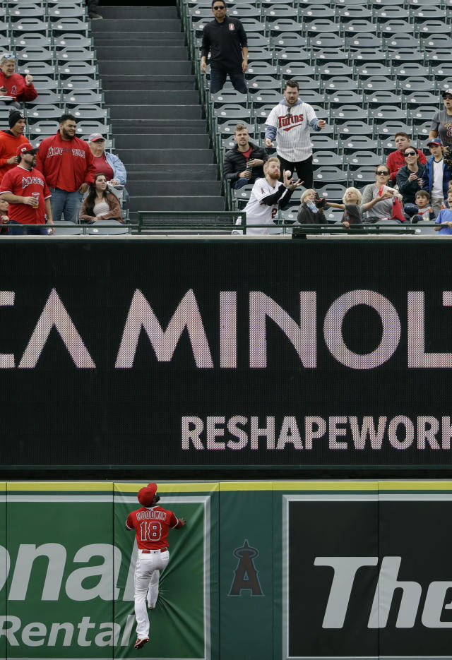Los Angeles Angels center fielder Brian Goodwin, bottom, watches as a two-run home run by Minnesota Twins' Jorge Polanco goes over the wall during the second inning of a baseball game Thursday, May 23, 2019, in Anaheim, Calif. (AP Photo/Marcio Jose Sanchez)