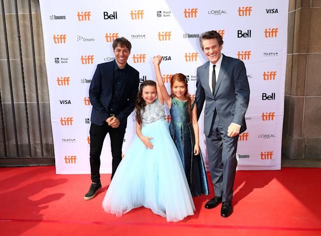 """Sean Baker, Brooklynn Prince, Valeria Cotto and Willem Dafoe attend the """"Florida Project"""" premiere at the Toronto Film Festival on Sept. 10, 2017. (Joe Scarnici via Getty Images)"""