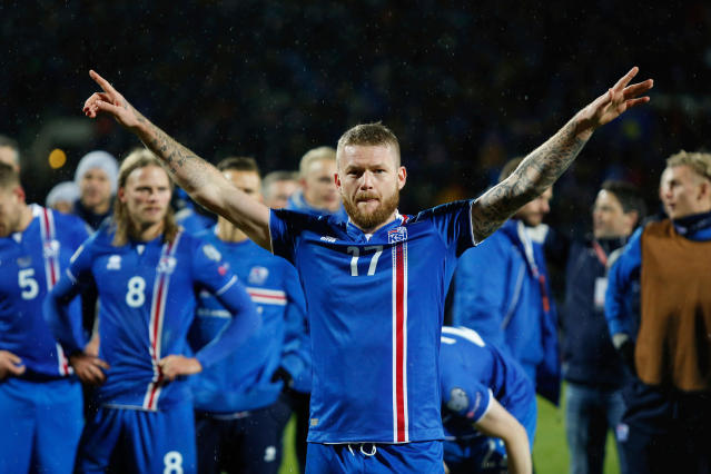 FILE - In this Monday Oct. 9, 2017 filer, Iceland's captain Aron Gunnarsson celebrates at the end of the World Cup Group I qualifying soccer match between Iceland and Kosovo in Reykjavik, Iceland. Icelandic footballers are the tallest at the World Cup in Russia, with an average height of 1.85 meters (just over 6 feet), making them especially strong in aerial duels in defense and attack. (AP Photo/Brynjar Gunnarsson, File )