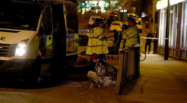 Police and emergency services remain in the streets of Manchester following the possible terrorist attack. Source: AP