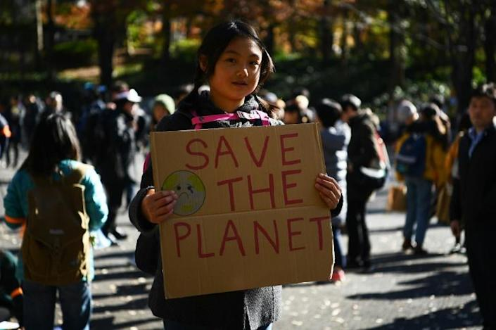 Hundreds marched through Tokyo's teeming Shinjuku district to raise awareness about climate change (AFP Photo/CHARLY TRIBALLEAU)