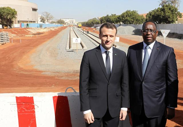 French President Emmanuel Macron and Senegalese President Macky Sall pose as they visit a Regional Express Train (TER) railway station in Dakar, Senegal, February 2, 2018. REUTERS/Ludovic Marin/Pool