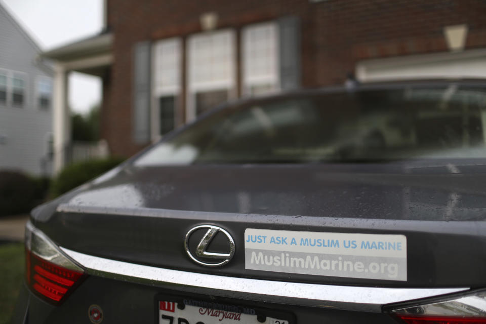"""A sticker reading """"Just ask a Muslim US Marine"""" sits on the back of Mansoor Shams' vehicle at his home in Baltimore, on Friday, Aug. 13, 2021. Shams, who served in the Marines from 2000 to 2004, was called names like """"Taliban,"""" """"terrorist"""" and """"Osama bin Laden"""" by some of his fellow Marines after 9/11. In recent years, Shams has used his identity as both a Muslim and a former Marine to dispel misconceptions about Islam. (AP Photo/Jessie Wardarski)"""