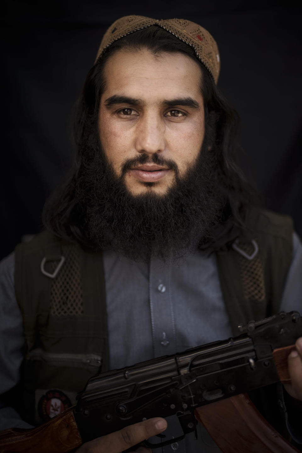 Taliban fighter Harris Al-Baghlani, 26, poses for a photo at a police station in Kabul, Afghanistan, Thursday, Sept. 16, 2021. Al-Baghlani studied religion, politics and is a trained sniper. He has been a Taliban since he was 14 years old. (AP Photo/Felipe Dana)