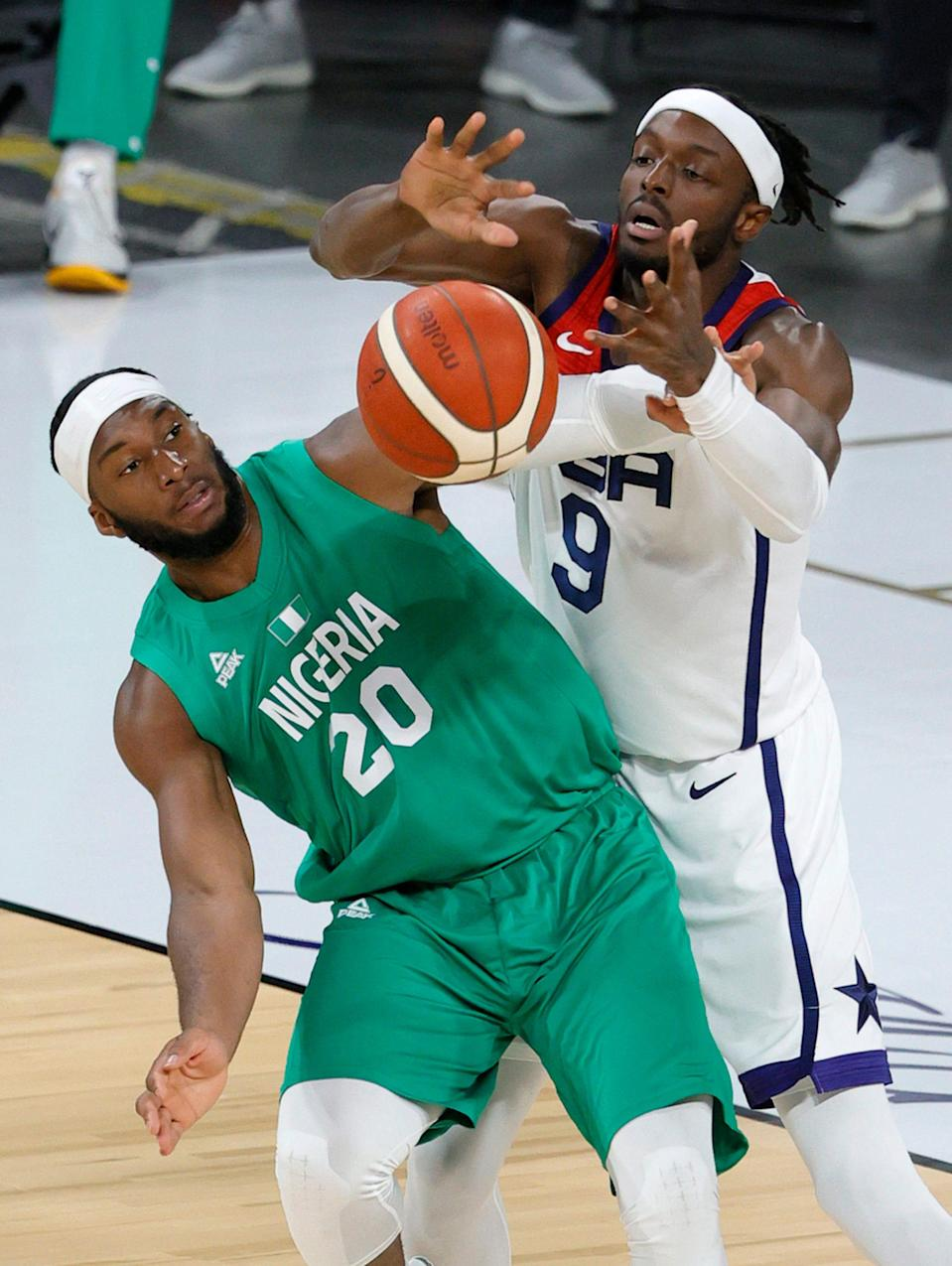 Josh Okogie of Nigeria and Jerami Grant of the United States fight for a rebound during an exhibition game at Michelob ULTRA Arena ahead of the Tokyo Olympic Games on July 10, 2021 in Las Vegas, Nevada.