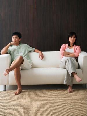 couple fighting on a sofa