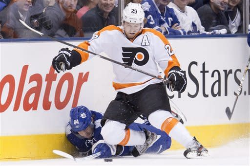 Toronto Maple Leafs' Mikhail Grabovski (84) battles for the puck with Philadelphia Flyers' Claude Giroux during the first period of an NHL hockey game in Toronto on Saturday, March 10, 2012. (AP Photo/The Canadian Press, Chris Young)