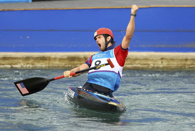 <p>Casey Eichfeld of USA celebrates after his run in the men's canoe single final at Whitewater Stadium in Rio on August 9, 2016. (REUTERS/Lucy Nicholson) </p>