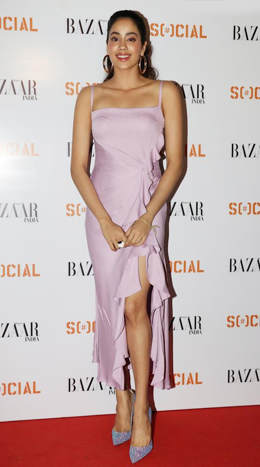 <p>For unvieling of her magazine cover with Harper's Bazaar, Kapoor picked a gorgeous coloured ruffled dress, with a slit, by Prabal Gurung. With her hair pulled back in to a ponytail, she rounded out the look with hoop earrings, a graphic cocktail ring and pair of sparkly <em>Louboutin</em> pumps. </p>