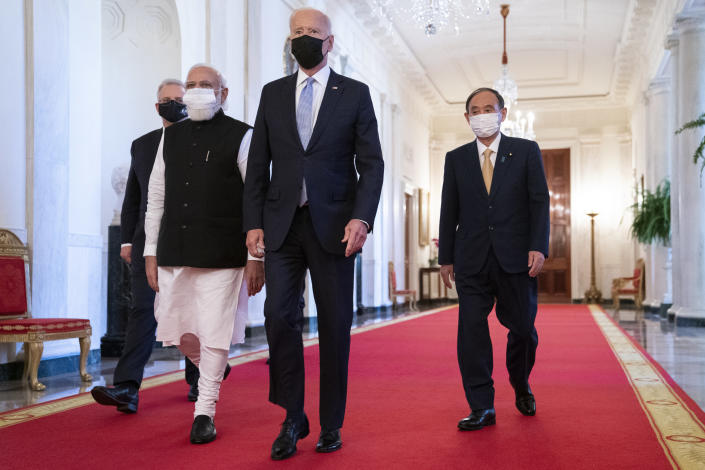 President Joe Biden walks to the Quad summit with, from left, Australian Prime Minister Scott Morrison, Indian Prime Minister Narendra Modi, and Japanese Prime Minister Yoshihide Suga, in the East Room of the White House, Friday, Sept. 24, 2021, in Washington. (AP Photo/Evan Vucci)