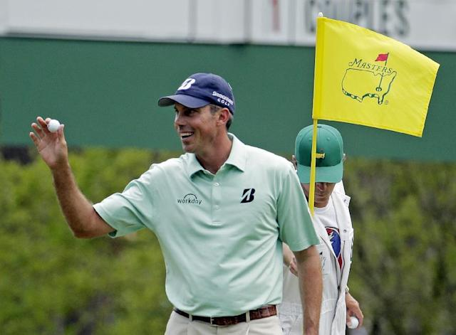Matt Kuchar holds up his ball after a birdie on the third hole during the fourth round of the Masters golf tournament Sunday, April 13, 2014, in Augusta, Ga. (AP Photo/Charlie Riedel)
