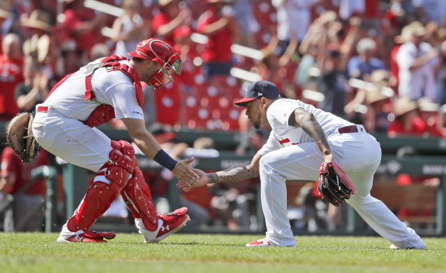 St. Louis Cardinals relief pitcher Carlos Martinez, right, and catcher Andrew Knizner celebrate following a 5-2 victory over the Arizona Diamondbacks in a baseball game Sunday, July 14, 2019, in St. Louis. (AP Photo/Jeff Roberson)