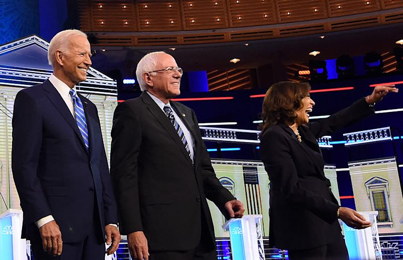 Democratic presidential candidates (from L) former U.S. Vice President Joe Biden, Vermont Sen. Bernie Sanders, and California Sen. Kamala Harris pose for photographers before the first Democratic presidential primary debate for the 2020 election on June 27, 2019 at the Knight Concert Hall at the Adrienne Arsht Center for the Performing Arts in Miami, Florida. (Photo by Paul Hennessy/NurPhoto via Getty Images)