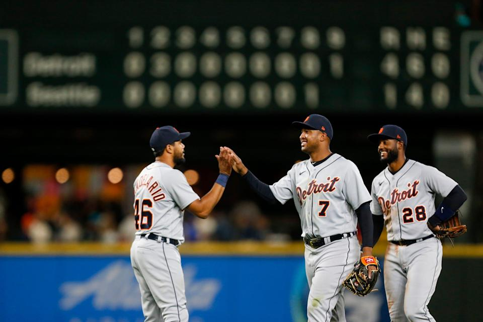Detroit Tigers second baseman Jonathan Schoop (7) and third baseman Jeimer Candelario (46) exchange high fives following a 4-1 victory against the Seattle Mariners at T-Mobile Park.