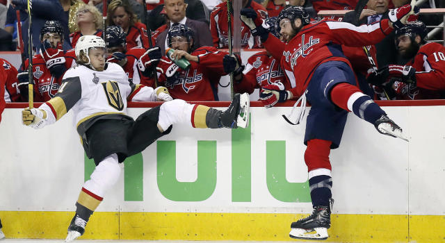 "<a class=""link rapid-noclick-resp"" href=""/nhl/players/5421/"" data-ylk=""slk:William Karlsson"">William Karlsson</a>, left, of Sweden, falls to the ice after a hit by <a class=""link rapid-noclick-resp"" href=""/nhl/teams/was"" data-ylk=""slk:Washington Capitals"">Washington Capitals</a> forward <a class=""link rapid-noclick-resp"" href=""/nhl/players/5696/"" data-ylk=""slk:Tom Wilson"">Tom Wilson</a>. (Alex Brandon/AP)"