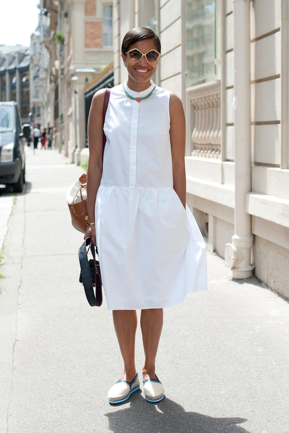 <p>A feminine, white sundress gets a dose of menswear-inspired cool via these loafer-like flats.</p>