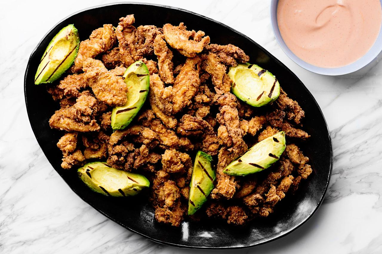 "Inspired by Spanish flavors, this fried chicken gets a spicy boost in both the marinade and the seasoned breading. The final touch—grilled avocados—is a little extra but oh so good. <a href=""https://www.epicurious.com/recipes/food/views/spanish-style-fried-chicken-with-grilled-avocado?mbid=synd_yahoo_rss"">See recipe.</a>"