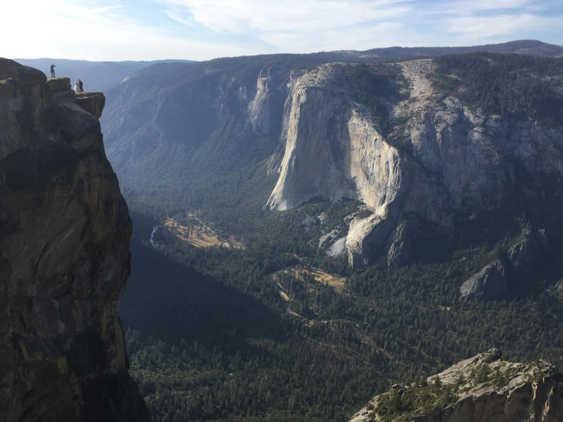Two visitors fall from Taft Point in Yosemite National Park