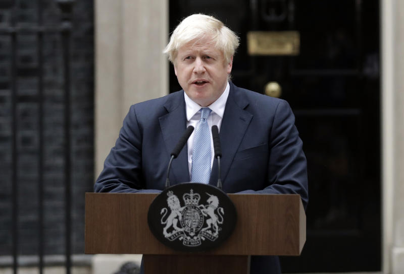 Britain's Prime Minister Boris Johnson speaks to the media outside 10 Downing Street in London, Monday, Sept. 2, 2019. Johnson says chances of a Brexit deal are rising .(AP Photo/Matt Dunham)