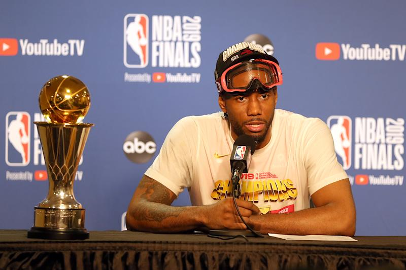 OAKLAND, CA - JUNE 13: Kawhi Leonard of the Toronto Raptors appears with the Bill Russell NBA Finals MVP trophy following the conclusion of Toronto's 114-110 win over the Golden State Warriors in Game 6 of the 2019 NBA Finals on June 13, 2019 at Oracle Arena in Oakland, CA. (Photo by Daniel Gluskoter/Icon Sportswire via Getty Images)