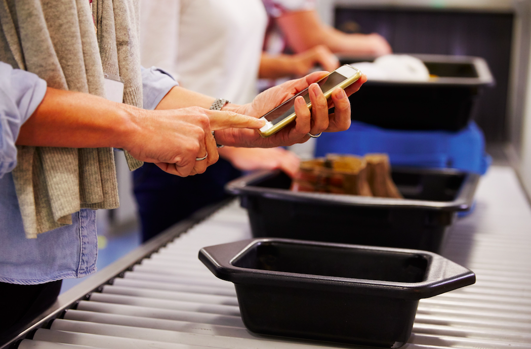 <em>Plastic security trays harbour the highest levels of viruses at airports, according to a study (Rex)</em>
