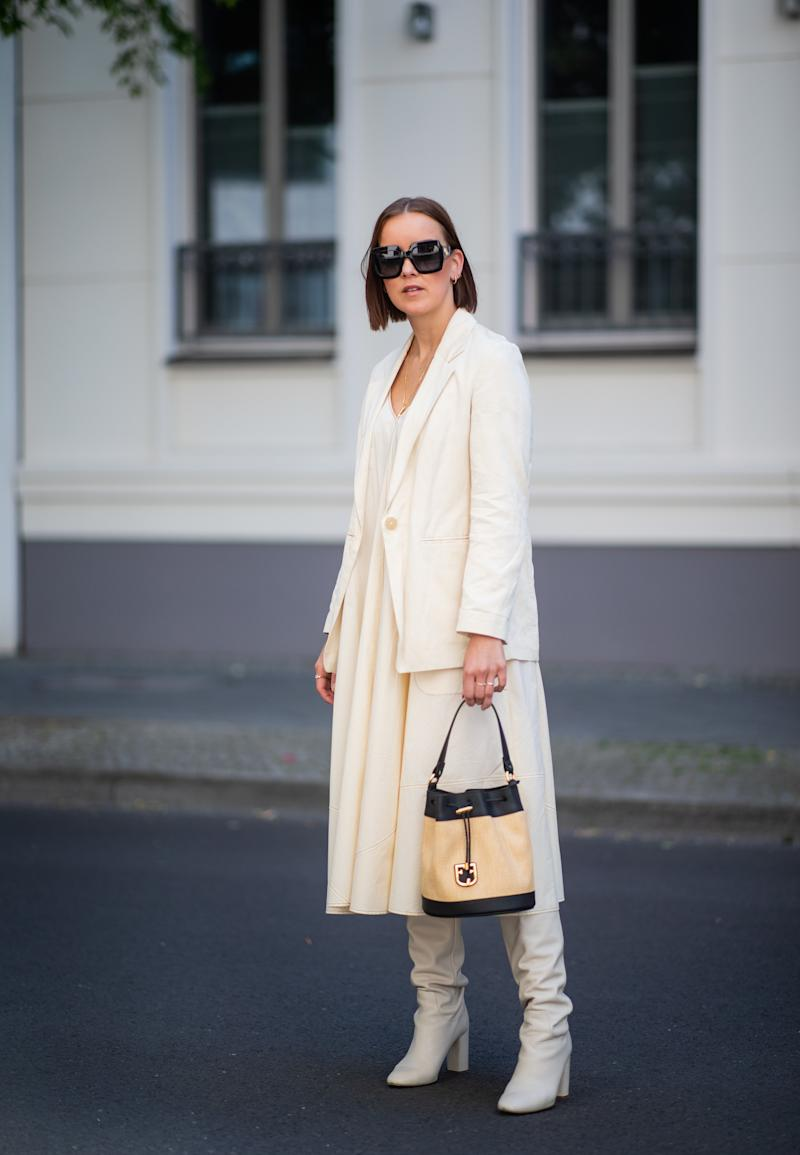 BERLIN, GERMANY - MAY 31: Tina Haase is seen wearing creme white Drykorn blazer and dress, Zara boots, Furla bag, Celine necklace, Gucci sunglasses on May 31, 2019 in Berlin, Germany. (Photo by Christian Vierig/Getty Images)