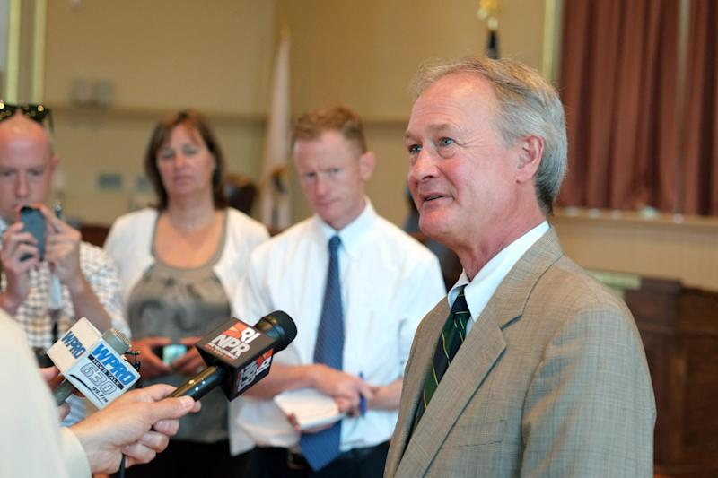 Rhode Island Gov. Lincoln Chafee talks with the media after registering as a Democrat at City Hall in Warwick, RI on Thursday, May 30, 2013. (AP Photo/Joe Giblin)