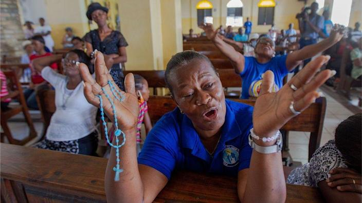 Parishioners pray in Saint Antoine Church, where Father Michel Briand, one of the religious kidnapped days ago, worked for decades, in Port-au-Prince, Haiti, on 23 April